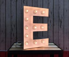 Stylish vintage light up letters with incandescent bulbs, creating a harmonic element of your home or business. We use the highest quality material to ensure you receive the product you will be proud of!  There is a discount available for more than two letters.   Specification:  - Our Light up letters are 100% handmade in the UK by our skilled craftsmen! - Hight: 40cm; - 100 mm polished metal returns; - Painted satin finish with clear bulbs; - Filled edges for smoother look; - Bulbs…