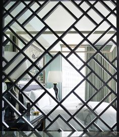 A geometrical screen divides the bedroom and bathroom at Viceroy Miami. #kellywearstler
