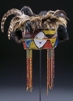 Diviners headdress (nkaka), mid-20th century Medium:Leather, fiber, beads, and feathers  Geographic location: Africa, Democratic Republic of the Congo,Tabwa  Courtesy of the Dallas Museum of Art