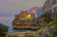 Polignano by night - the first lights light up on the village of Polignano