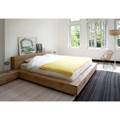 This Ethnicraft Oak Madra Queen Bed features a solid and sturdy low-lying frame coupled with a simple and perennial design, drawing attention to light and space in your bedroom interior with its organic, natural pale colour. Ethnicraft uses tested timber Bedroom Bed, Bedroom Furniture, Home Furniture, Bedroom Decor, Modern Furniture, Bedroom Ideas, Master Bedroom, Bedrooms, Simple Bedroom Design