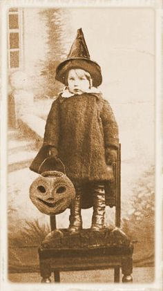 little witch with lantern, Looking at this home made outfit for Halloween, and this Pumpkin to collect candy...Nothing has changed much, but how mean some people can be, so we no longer can go door to door, but have to have parties...Such a shame....Kids love doing Trick or Treat.....