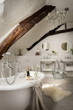 There's just something about having a bathroom with exposed wooden beams that does it for us. Lovely stuff!