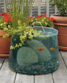 An awesomely cool idea for your outside patio or deck - an aquarium fountain! So cool!