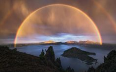 Five mile wide double rainbow during a thunderstorm 8000ft above sea level in Crater Lake National Park, Oregon.