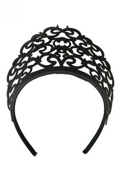 This Morgan and Taylor laser cut filigree pattern headpiece is a unique and stylist fascinator, perfect for race day. Laser Cut Crown Made with Leather Filigree Pattern Made in Melbourne