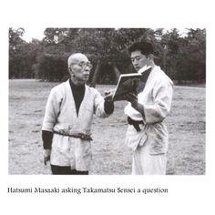 Soke Hatsumi asking Takamatsu Sensei a question, he looks like such a dapper young man here