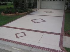 Concrete Driveway Design Ideas terrific open plan driveway landscaping using grey concrete and white garage door also grey exterior wall Entrance Driveway Concrete Driveways Mcaleer Concrete Design Spanish Fort Al