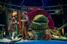Tiffany Trainer and Jonathan Lee Cunningham with Audrey II in the monster musical hit LITTLE SHOP OF HORRORS at Theatre at the Center - www.theatreatthecenter.com