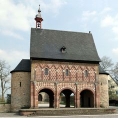 Carolingian Architecture: Gatehouse Lorsche Abbey - end 9th century - a modest building, but still announces the grander architecture of the Abbey with the characteristic rounded towers either end