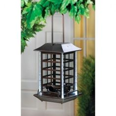 Solar Bird Feeder Lantern  Clever garden accent is a delight both day and night! Handsome bronze finish lantern is a generous birdfeeder by day; after dark, hidden solar lights soften the evening with a gentle glow CLICK HERE TO SHOP>> http://wayeshomeaccessories.weebly.com/outdoor-solar-powered-lighting.html