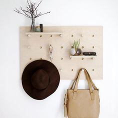 Help keep your accessories organized with this DIY Pegboard Wall Organizer.