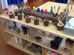 Lovely art resource shelves, with log storage