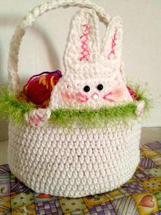 Free Crochet Pattern for Easter Baskets using a rabbit to accent the basket. Free pattern by Cathy Cunnigham of The Crochet Crowd.