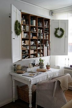 Perfect for hiding office clutter/stuff. Love the wreaths, but on the outside of the doors when shut. :)