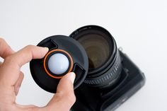 White Balance Lens Cap.   Set white balance to custom, take a photo (with the cap on) and presto! Perfectly balanced color. Cool!