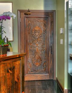 A beautiful custom-carved door makes for a unique, personalized space.