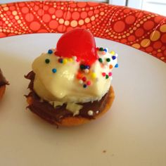 Mini banana split! Nila wafer, a bit of nutella, a slice of banana, dollop of whip cream, add sprinkles and half a cherry!