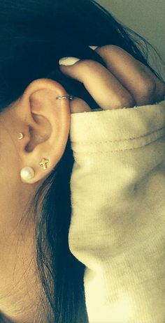 Cute piercings. I especially love the crescent moon in the tragus