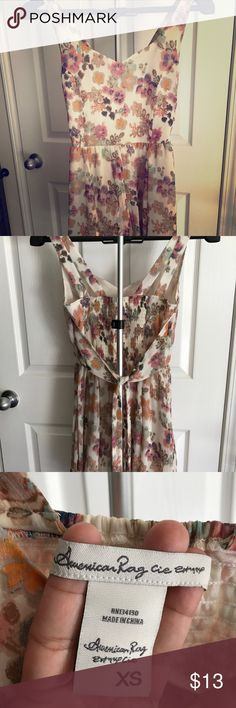 "American Rag dress XS Floral American Rag dress XS, my daughter used it ONCE and now it's out of style 🤦🏻‍♀️she is a 5'2"", 115lbs. And it fits a little lose on the top and is above her knees. American Rag Dresses Mini"