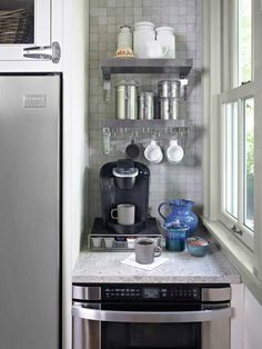 Mugs hang from S hooks, and a microwave drawer lives below the countertop for quick reheats of morning joe. Description from pinterest.com. I searched for this on bing.com/images