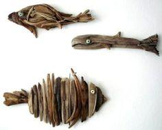 decoration en forme de poissons de bois flotte accroches au mur
