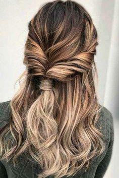medium length hairstyle twisted half up half down hair style
