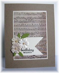 big block of sheet music with white pennant and flowers