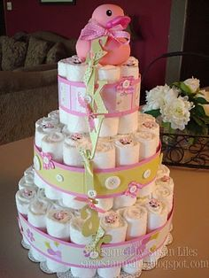 @Erika Goodman, here's your diaper cake tutorial!  (I've also seen it with a bottle of champagne in the middle, in place of the powder and baby bottle.)