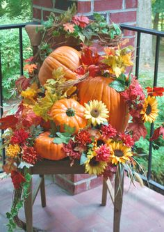 Got an old chair collecting dust in your attic? Turn it into a fall showcase with pumpkins, vines, leaves, and flowers.
