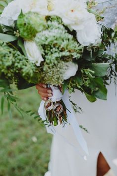 modern green and white bouquet with locket