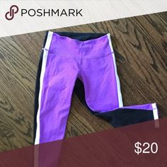 Cropped exercise pants Tri-color exercise pants. Purple front with black back and white accent stripe down side and around ankle. These hit just below the knee. Great condition. lululemon athletica Pants Leggings