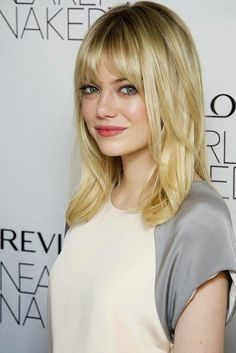 Emma Stone: Medium Length straight hair with bangs and layers Now I'm thinking, really thinking bout getting this hair cut
