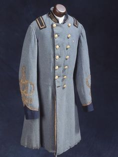 Frock coat worn by Henry Clay Albright, Company G, Twenty-sixth Regiment North Carolina Troops, ca. 1862. The shoulder straps conform to 1861 regulations for officers' uniforms.  NC Museum of History.