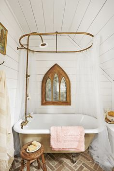 Bathroom: To spiff up this space, Jenna (once again) broke out the white paint and then went to work on the bathtub, which she refinished with a furniture-specific paint and sealed with a wax treatment.
