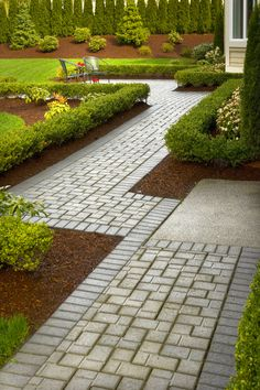 The smallest details matter- create intricate tiling patterns for your outdoor pathways. #customhomes #landscaping