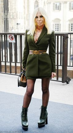 Youthful look: Donatella Versace opted for a milirary chic look to attend Milan Fashion Week's opening lunch on Wednesday