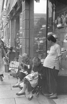 China. Street sewing vendors outside an upscale hat shop in the 1940's. Pictures are from the book entitled Shanghai 1949 The End of an Era  by Sam Tata