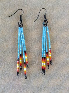 Hand made earrings crafted in the traditional Native American style. Traditional or custom colors/ styles available upon request. Custom orders may take up to an additional 5 days before shipped. Price is for one pair of hoop earrings and includes shipping via USPS. Approximate size - 2.5 inches diameter.