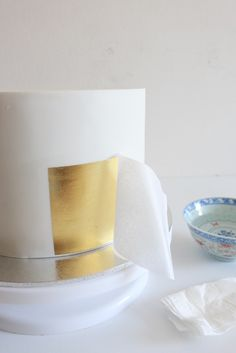 How to cover a cake in gold leaf ~ Sugar Bee Cakes/The Sweetest Bite Blog