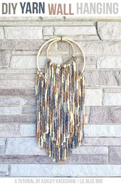 DIY Yarn Wall Hanging using chunky yard and embroidery hoops with fall colors. #michaelsmakers #macrame #embroideryhoop