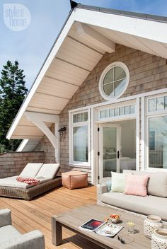 The exterior is clad in cedar shingles with a warm grey wash to make them look weathered. Clear cedar on the master deck resembles the interior oak floors and offers a seamless transition from indoors to out.