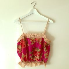 Anthropologie floral crop top This is a delicate cropped camisole by Only Hearts N.Y.C purchased @ Anthropologie.  It is a fun & vintage inspired floral print full of lish reds, pinks, greens, and tans.  Beautiful lace details around both hems.  Bottom hem is elastic. Anthropologie Tops Crop Tops