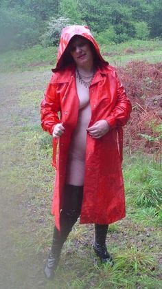 Absolute sensuality - hooded red rubberized satin lining, rubber boots and nothing on underneath on a lovely rainy day!