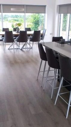 Our Pergo laminate flooring is water-resistant and Ideal for kitchen and bathroom floors. Pergo Laminate Flooring, Dining Chairs, Dining Table, Bathroom Flooring, Floors, Water, Kitchen, Furniture, Home Decor