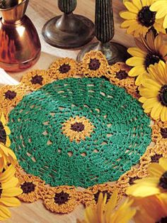 "Sunflower Doily - This colorful sunflower doily will brighten your summer decor.    Worked with size 10 crochet cotton using a size 7 steel crochet hook. Finished size: 11 1/2"" diameter.   Skill Level: Easy  Designed by Marilyn Flickner  free pdf from FreePatterns.com"