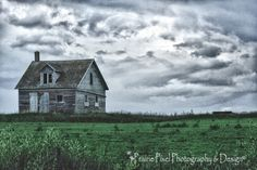Abandoned farmhouse with a storm brewing in the background