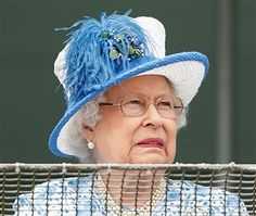 Queen Elizabeth II grimaces whilst watching the racing from the balcony of the Royal Box as she attends Derby Day during the Investec Derby Festival at Epsom Racecourse on June 4, 2016 in Epsom, England.