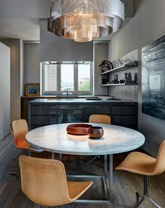 PK54 table and PK9 chairs by Poul Kjærholm from Fritz Hansen   dustjacket attic: Interiors   Modern Moscow Apartment - gray kitchen with amber accents