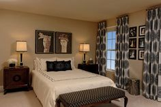 Drapes hung at ceiling for height. Contemporary bedroom by Paula Grace Designs, Inc.